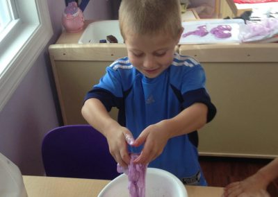 Boy with purple dough