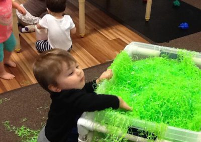 Boy with green confetti