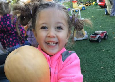 Smiling girl with squash