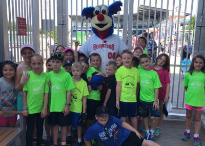 Children at Senators game with mascot
