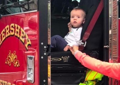 Infant sitting in a fire truck
